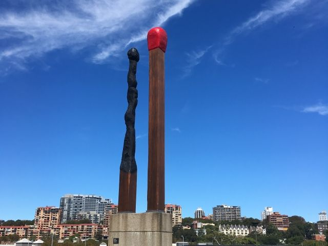sculpture or two giant matchsticks on a hill in Sydney