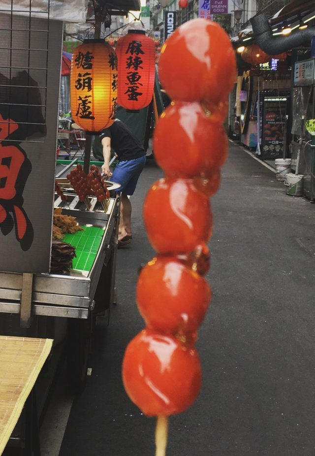 Eating at the night market is one of the top things to do in Taipei - we tried toffee tomatoes
