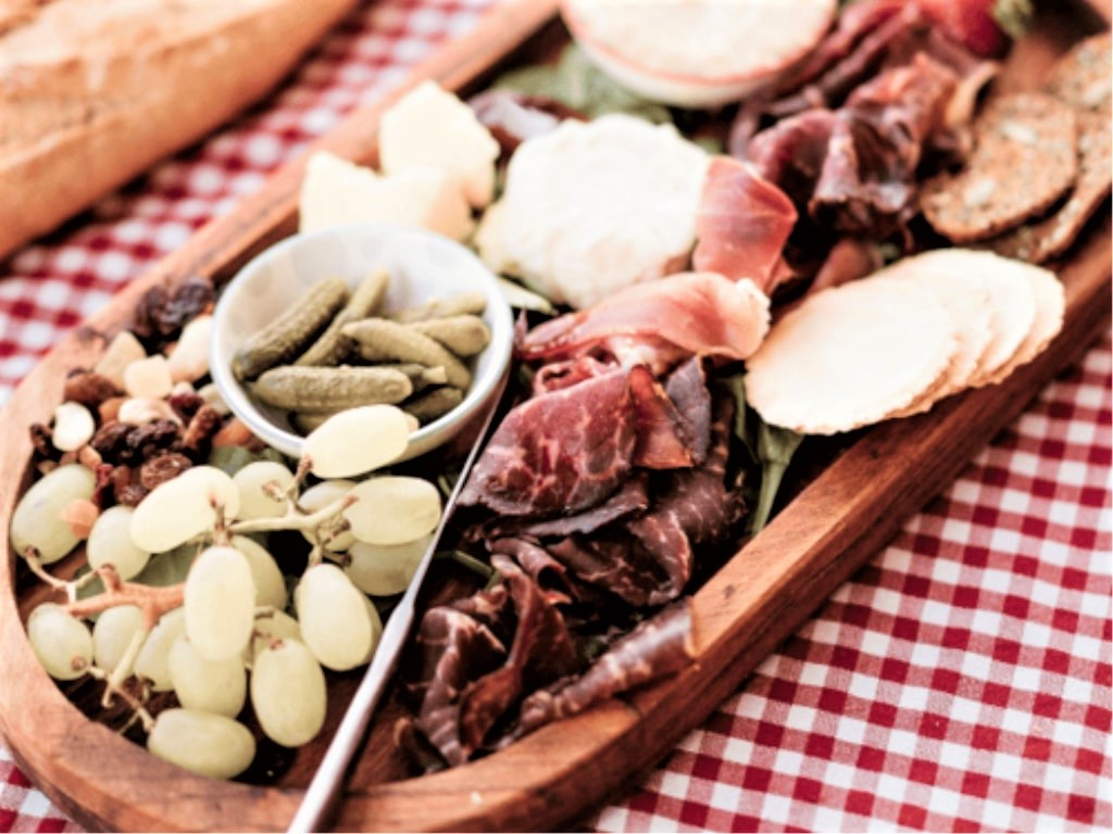 plate of meat, cheese and olives for a Mystery Picnic in Sydney