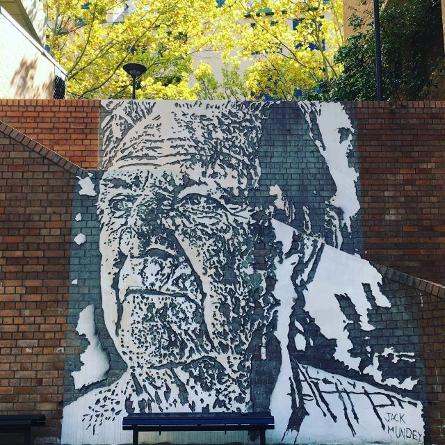 Finding this mural of activist Jack Mundey is one of the cool things to do in The Rocks, Sydney