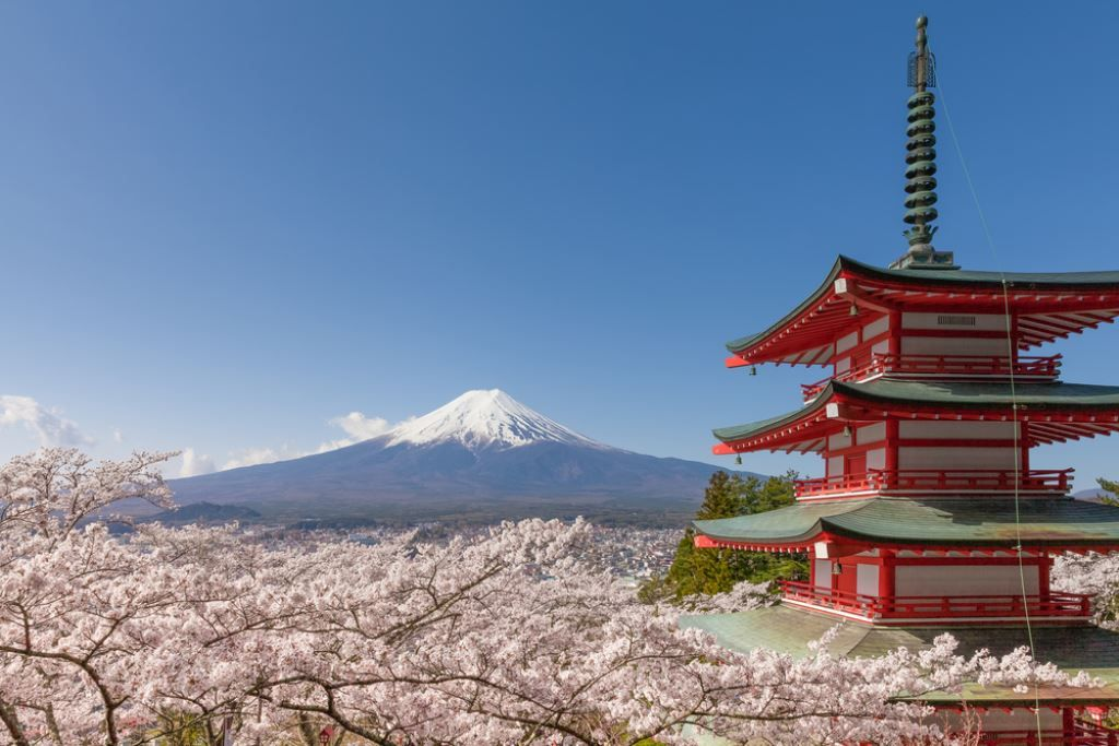 Red pagoda with Mount Fuji in the background