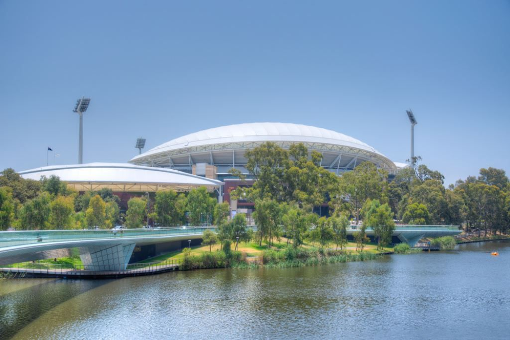 view of the curbed roof of  adelaide oval with the river in the foreground. Climbing it is one of hte fun things to do in Adelaide