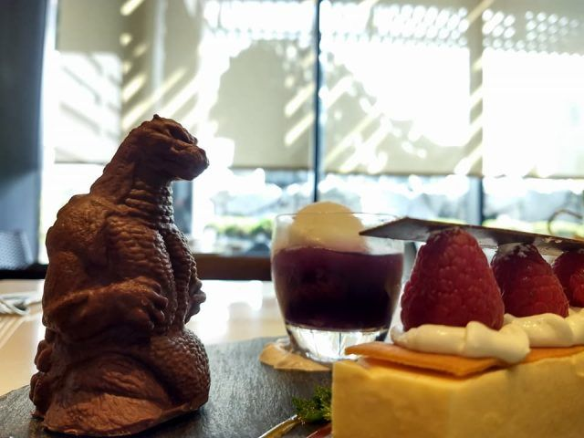 The cafe at the Shinjuku Gracery Hotel in Tokyo, sells Godzilla desserts - and gives you a chance to get up close and personal with the city's giant Godzilla head.