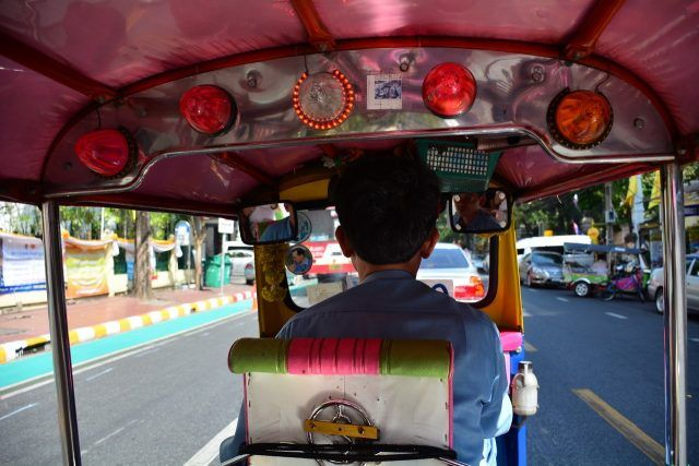 View from the passenger seat in a Bangkok tuk tuk - a must do on your first trip to Bangkok