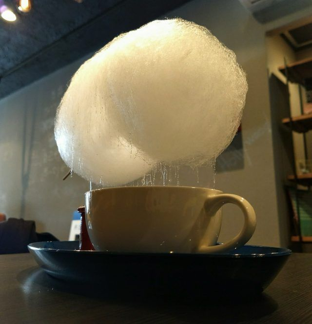 The Cloud Coffee from Alpha Food and Drink in Kyoto is a 'cloud' of white candy floss - as the steam from the drink hits it, it starts to melt, and rains into your drink.