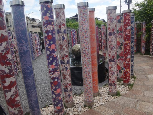The Kimono Forest is an art installation at Arashiyama station in Kyoto. There are over 600 kimono filled pillars in the display.