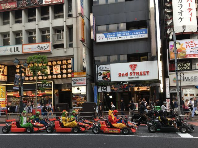 Riding a go kart in fancy dress around the streets of Tokyo is one of the weird things to do in Tokyo.