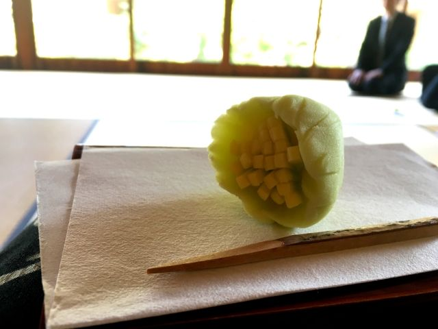 A traditional tea ceremony sweet called wagashi shaped like the flower of the plant Butterbur. At the teahouse in Matsue Japan.