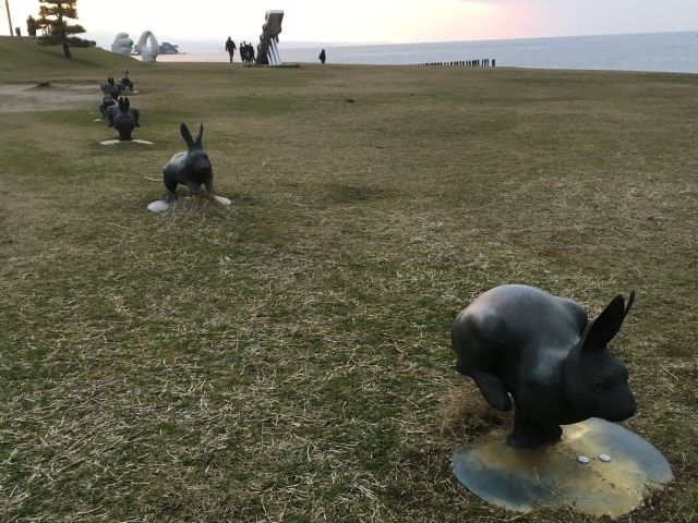 Statues of hopping rabbits in a line by Satosh Yabuuchi on the shore of Lake Shinji Matsue