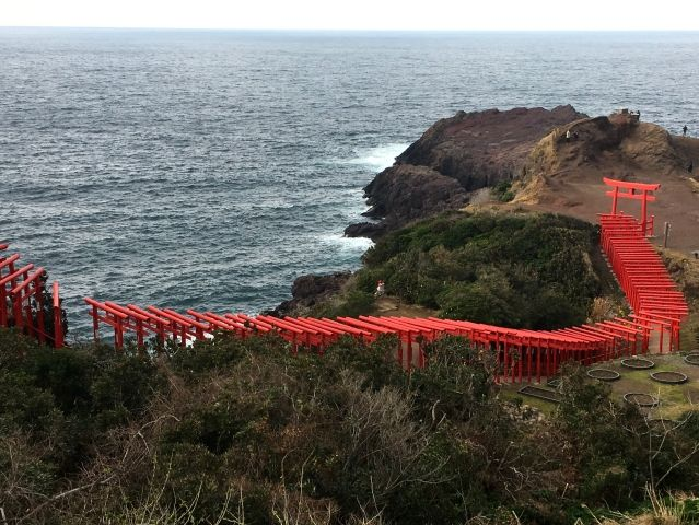 The beautiful Motonosumi Inari Shrine in Japan consists of 123 scarlet torii gates perched on top of a craggy rock by the sea.