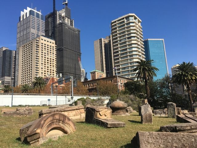 Pieces of what look like ruins jut out from the ground with the Sydney skyline behind them. This isMemory is Creation Without End, a fun artwork that's a cool thing to see near Circular Quay Sydney