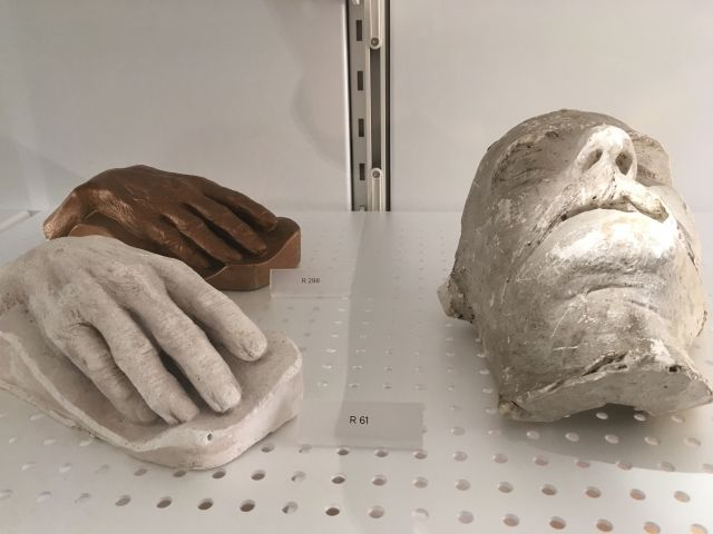 Cast of the face and hands of author Henry Lawson