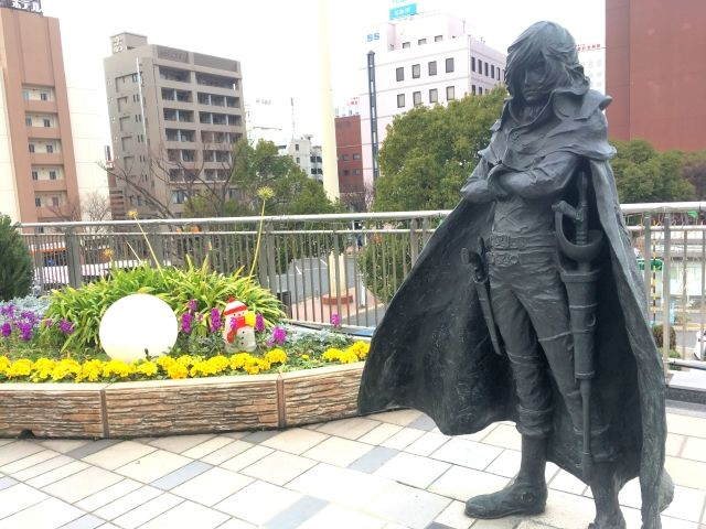 Manga statues at Kokura station. This is Captain Harlock and it's pictured in a long coat.