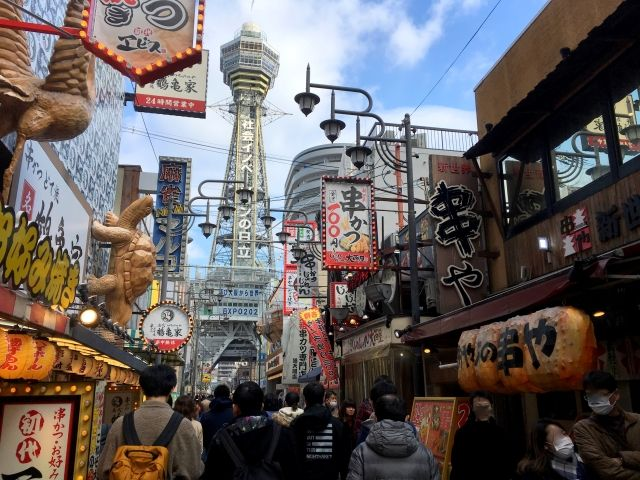 Street scene in Shinsekai Osaka with the Tsutenkaku Tower in the background