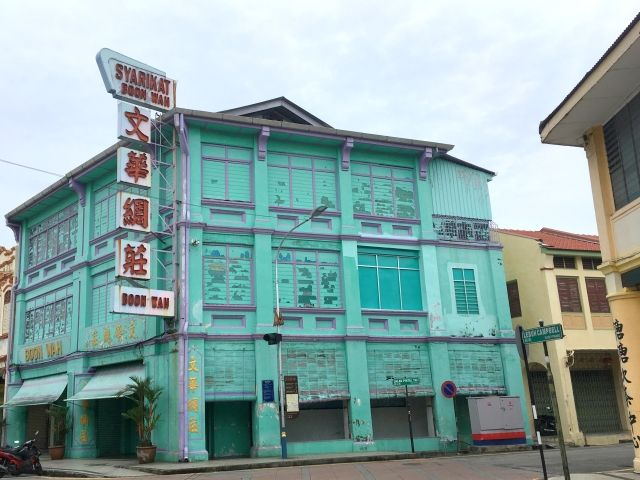 Pale Blue building with shutters in Penang