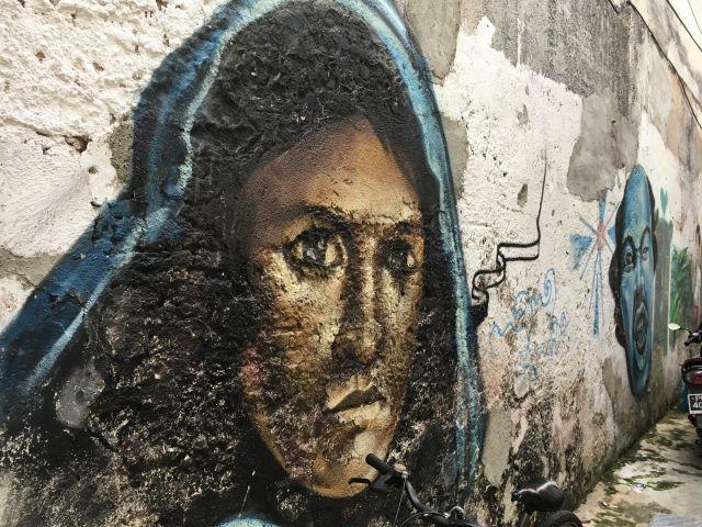 Street art image of girl in a headscarf