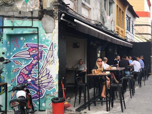 girl sitting outside bar in Malaysai