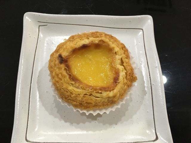 Durian tart with a bright yellow custardy centre and pastry outside