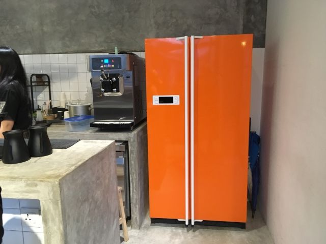 Bright orange fridge hiding the door to Out of Nowhere bar, Penang