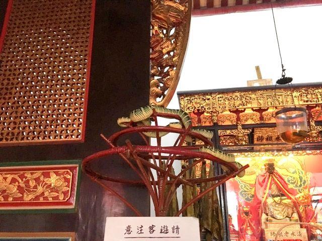 Snake coiled around an incense burner at Penang Snake Temple