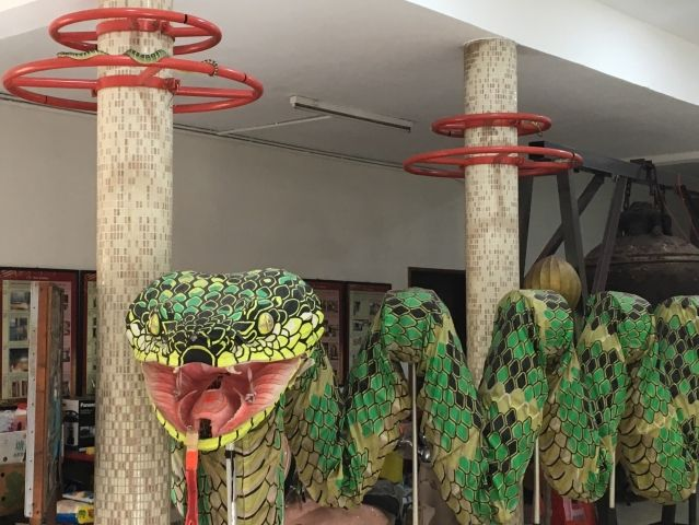 Giant Snake Puppet with live snakes sleeping above it