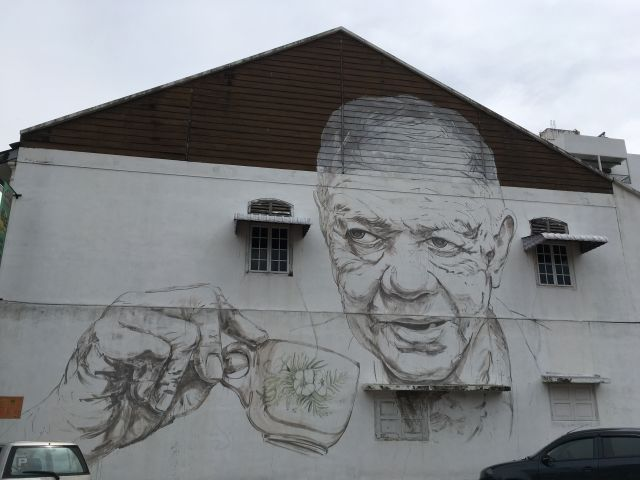 street art mural of older man drinking coffee in Ipoh Malaysia