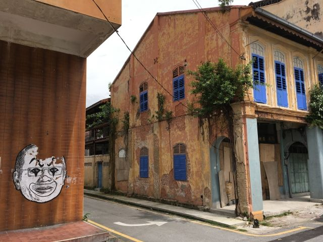 old terracotta and blue building in Ipoh Malaysia