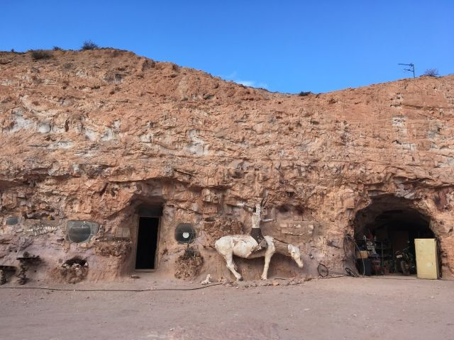 Three doorways built into a cave at Crocodile Harrys' Coober Pedy