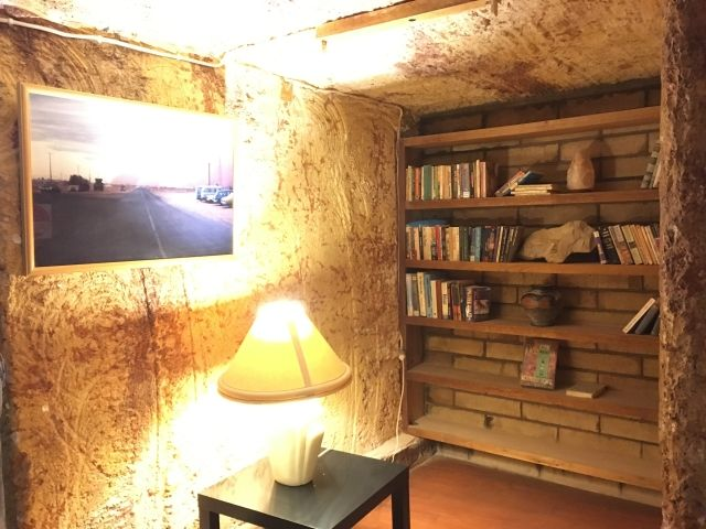 Undergound room with book shelves in Coober Pedy
