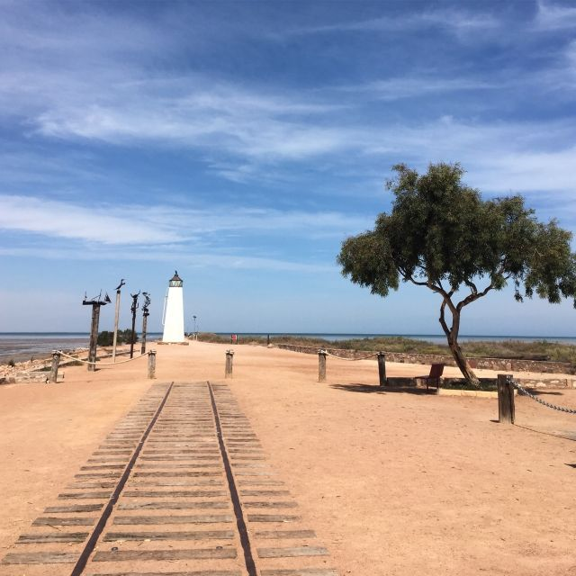 old rail track leading to a lighthouse