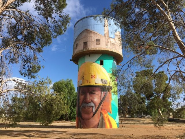 Painted water tower with an image of a firefighter