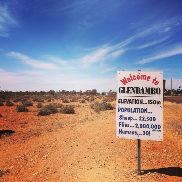 Sign comparing humans in Glendambo to the number of flies