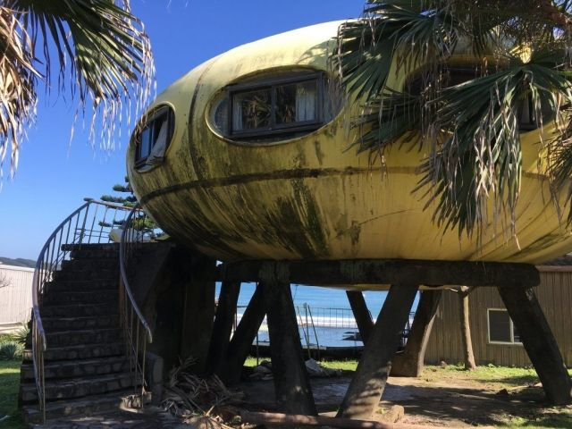 Side view of UFO House with stairs