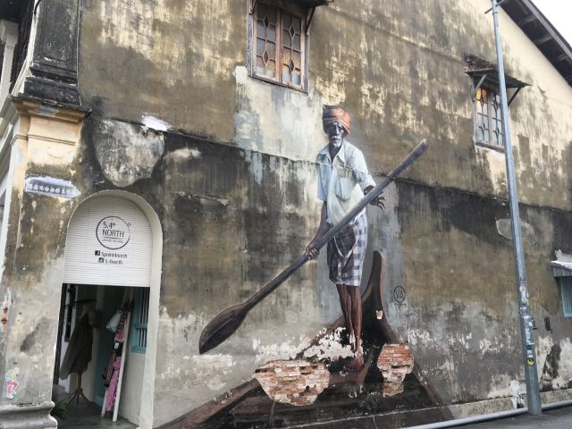 Mural of a fisherman on a canoe