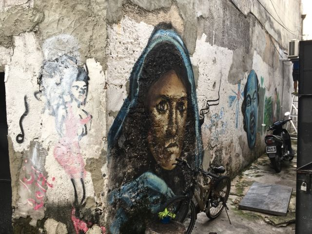 Street art mural in Penang based on famous National Geographic cover of a woman with blue eyes