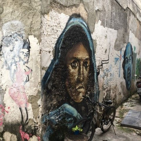 Street art mural of woman in a blue hood, Penang, Malaysia
