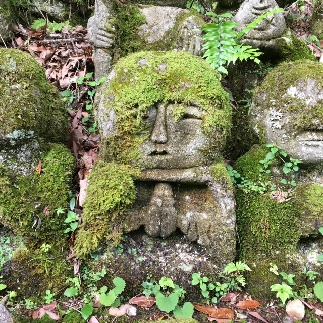 Stone figure covered in moss at a less touristy temple in Kyoto