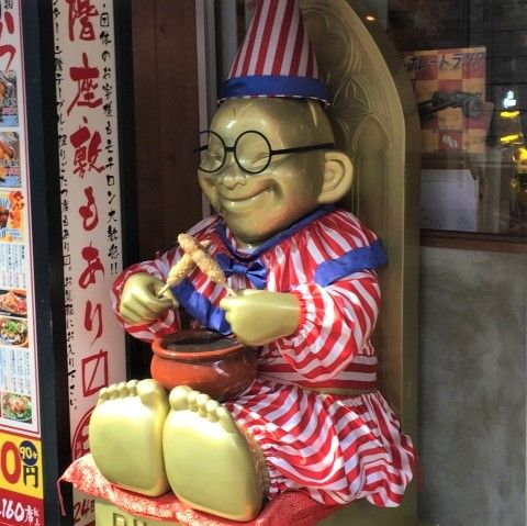 Billiken statue in a clown suit, Osaka Japan