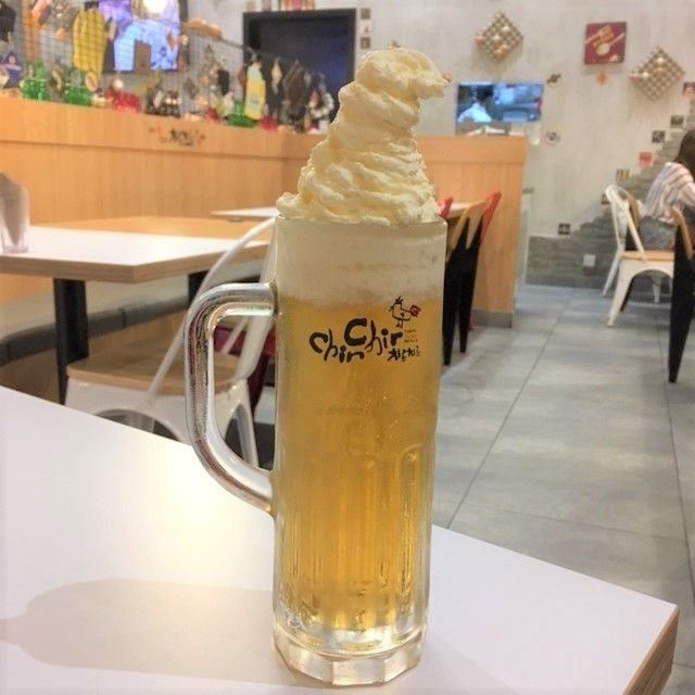 Pint of beer with whipped cream on top - one of the fun things to do in Kuala Lumpur for foodies