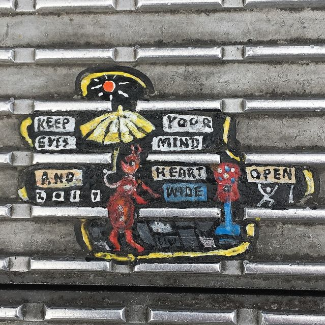 Chewing gum painting of an ant with an umbrella on the Millenium bridge, London
