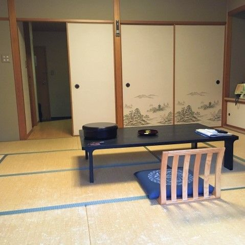 Traditional ryokan style room with tatami mat floor and a low table
