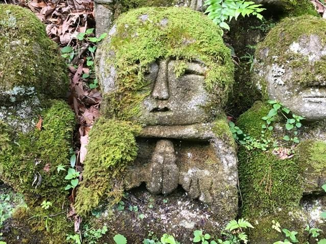 Stone figure covered in moss in Kyoto