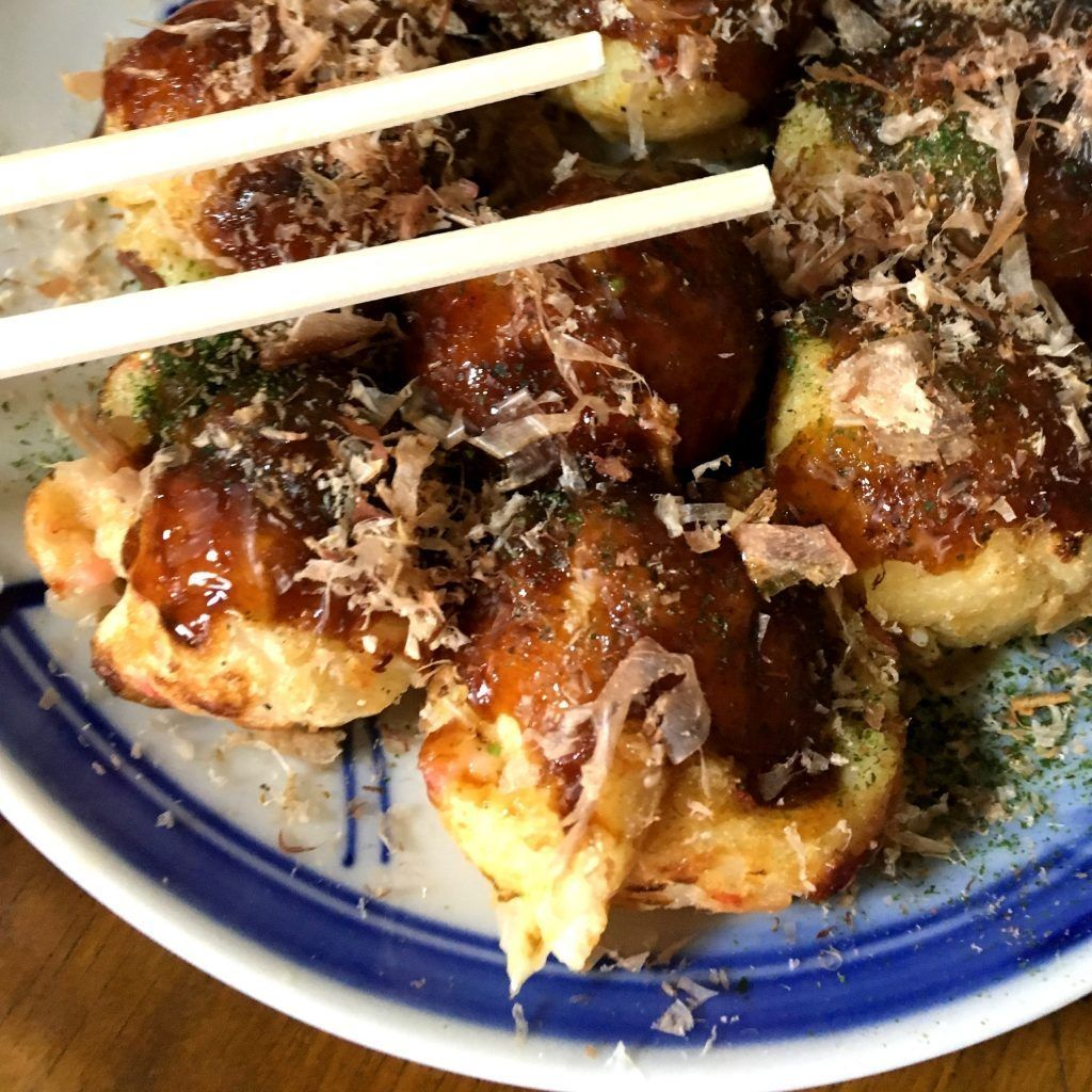 octopus balls with chopsticks