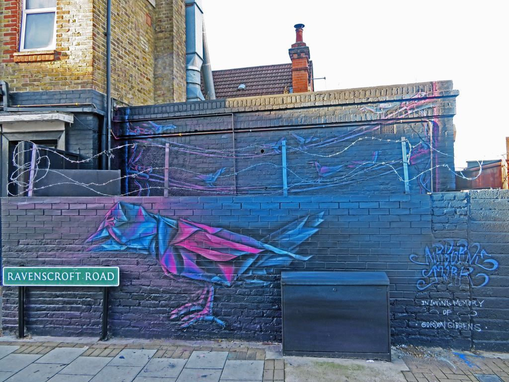 Street art mural of a bird in Penge, London