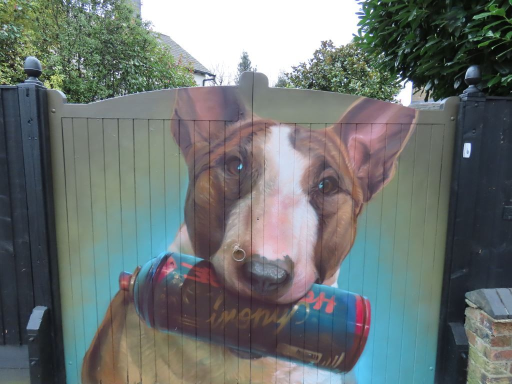 Street art mural of a bull terrior by artist Irony