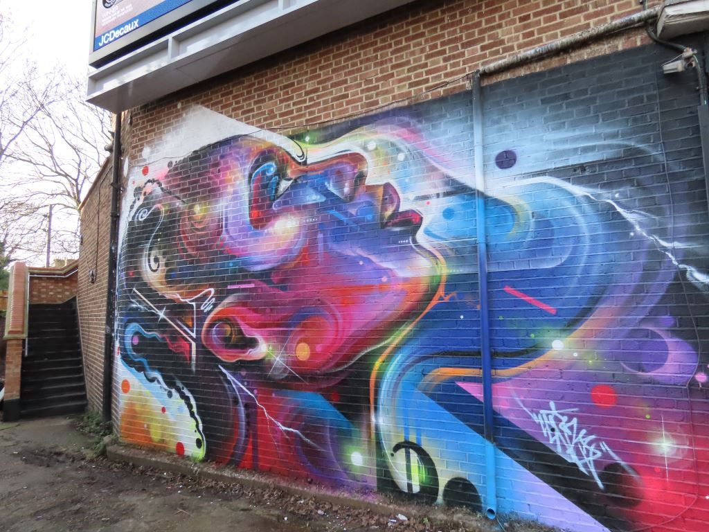 Street art mural of woman by artist Mr Cenz