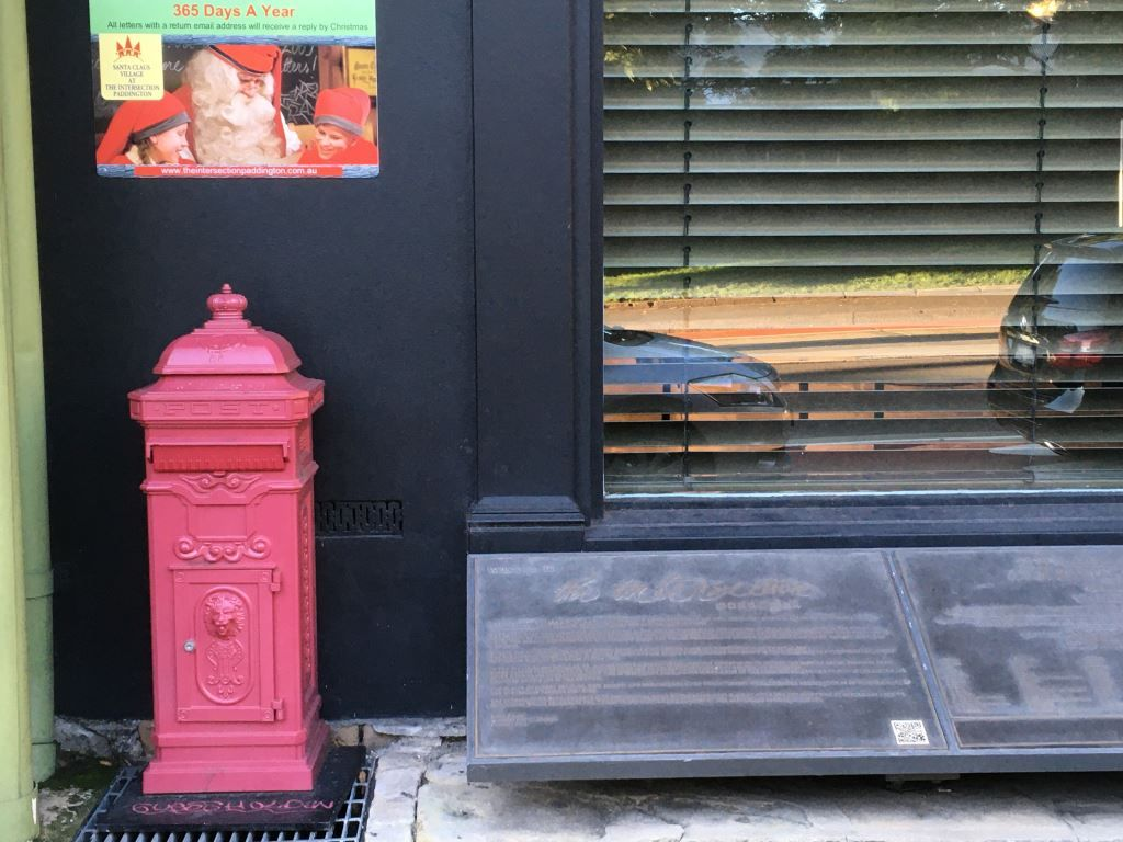 Red post box with letters to Santa above it
