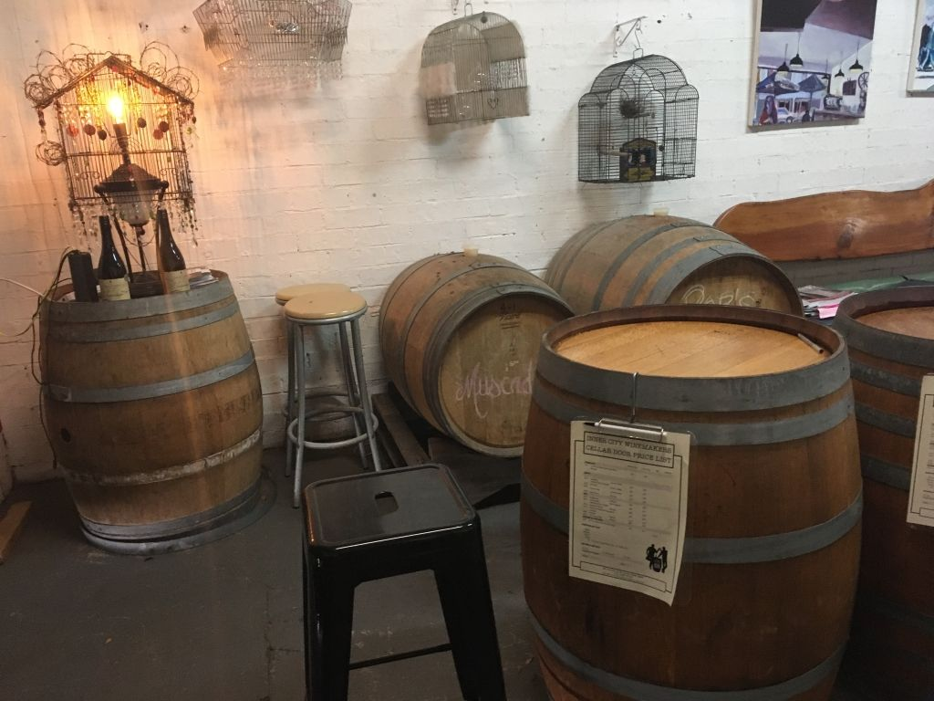 wine barrels and chairs in a tasting room
