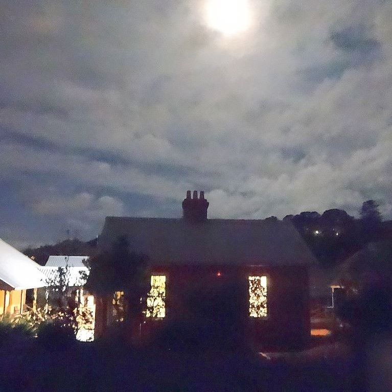 dark house under a full moon on the Q Station Ghost Tour in Sydney