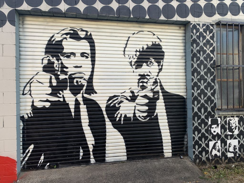 blacka dn white mural of jules and vincent, characters from Pulp Fiction